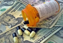 Pill bottle on US money (Photo credit: Flickr-ImagesMoney CC attribution 2.0)