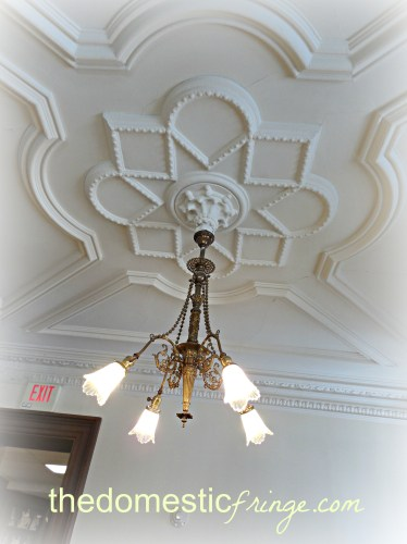 antinque light fixture in library