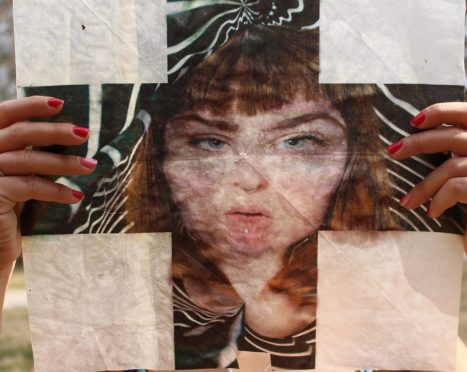 """Kayleigh Harris, """"Selfie"""", detail. Archival pigment print within pressed wax paper, 12.5 x 12.5 inches."""