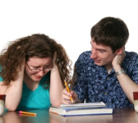 istock_princessdlaf-8-frustrated-female-teen-student-with-male-tutor-c