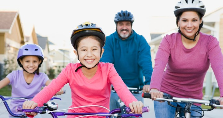 family riding bicycles together