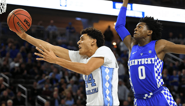 North Carolina's Justin Jackson flies past Kentucky's De'aaron Fox while attempting a layup on December 17th. (Photo by Ethan Miller)