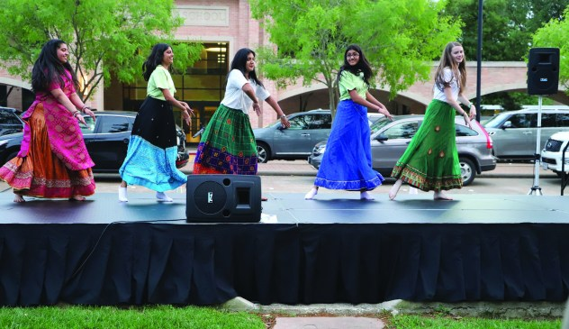 Members of the India Club perform a traditional dance.