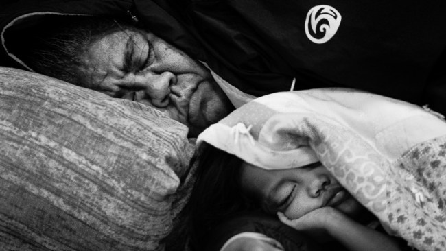 Mother sleeping with her daugter