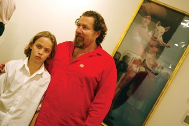 Julian Schnabel wiyth his son Vito in front of his art work at the annual Polaroid Benefit Auction (2004)