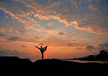 Yoga-at-sunrise-on-the-beach-at-Kamalaya
