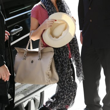 "Kylie Minogue carrying a ""Regina"" bag by Roberto Cavalli"