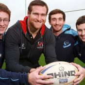 Neil McComb pictured with Belfast Met Rugby Academy students Ryan Duddy, Michael Whitall and Jonny Mooney.