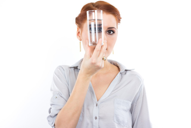 woman with water glass: is there atrazine in there?