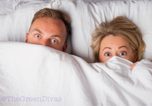 couple in bed pondering bamboo sheets on the green divas