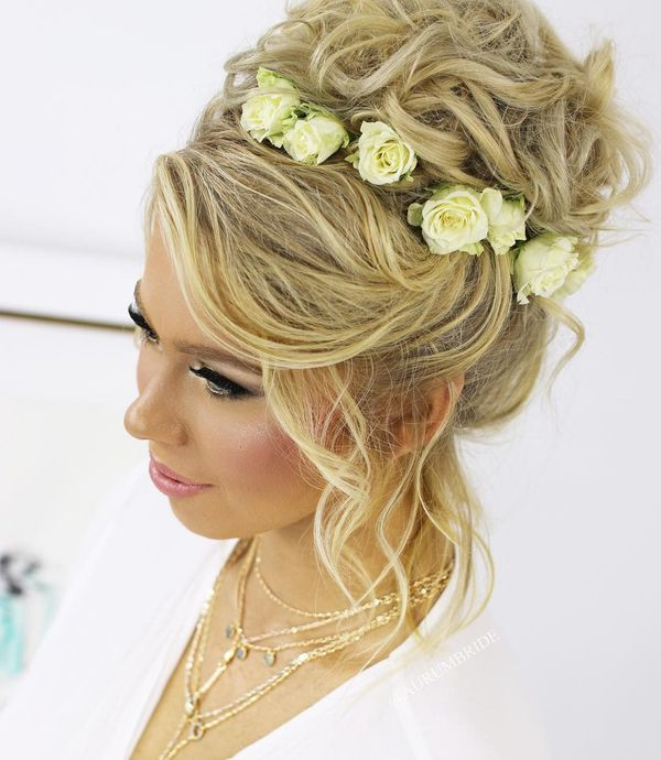 Loose curled bun with roses
