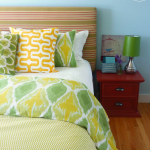 master bedroom for summer bed with mixed pattern bedding and large envelope cushions at thehappyhousie