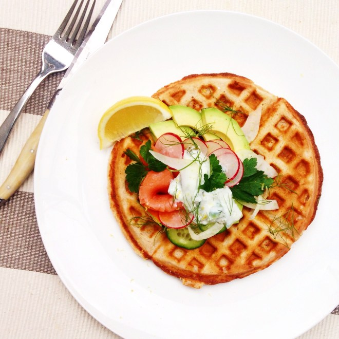 Waffle topped with smoked ocean trout, fennel, avocado, cucumber, raddish and a youghurt - dill - cucumber - cornichon sauce. Fresh lemon.