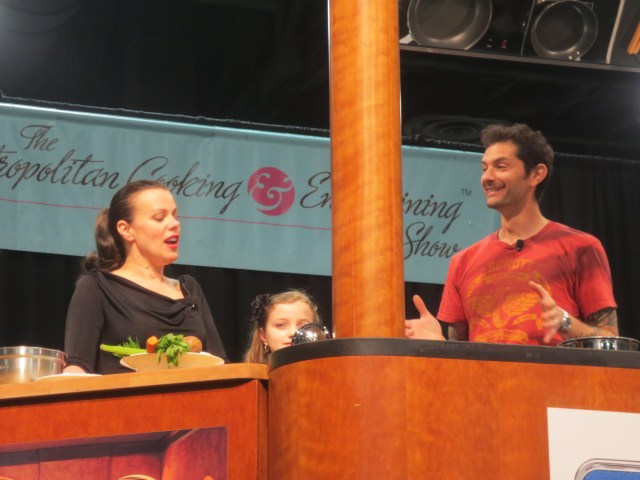 Debi Mazar, Gabriele Corcos and their daughter during a cooking demonstration