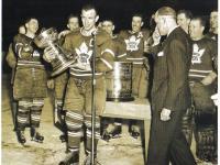 Leaf captain Teeder Kennedy cradles half a Stanley Cup in 1949