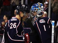 Columbus Blue Jackets Sammy Pahlsson congratulates Steve Mason after beating the St. Louis Blues 8-1 (Dave Gainer/THW)