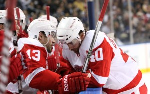 Darren Helm talks to center Henrik Zetterberg