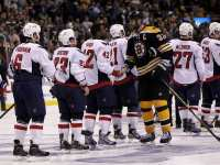 Chara shakes hands with the winning goal scorer Ward (Greg M. Cooper-US PRESSWIRE)