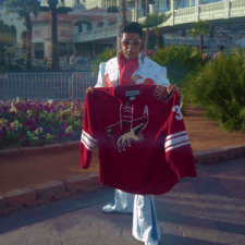 Elvis poses with Coyotes sweater across the street from Bellagio