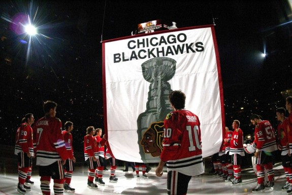 Oct 1, 2013; Chicago, IL, USA; Chicago Blackhawks center Patrick Sharp (10) stands with teammates as the 2013 Stanley Cup championship banner is raised to the rafters before the game against the Washington Capitals at the United Center. Mandatory Credit: Rob Grabowski-USA TODAY Sports