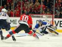 Blackhawks left wing Patrick Sharp  scores past St. Louis Blues goalie Ryan Miller with defenseman Kevin Shattenkirk pursuing during the third period in Game 6 of the first round of the 2014 Stanley Cup Playoffs. (Dennis Wierzbicki-USA TODAY Sports)