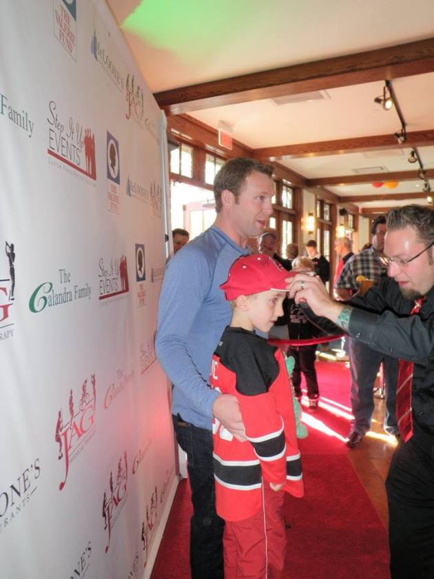Martin Brodeur poses with young Mat Kavchok at a benefit. (Photo by Alison Kavchok)