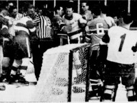 Linesman try to break up a fight between Claude Larose and Bruce MacGregor last night