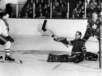 Johnny Bower makes a great save as Claude Provost (14) and Allan Stanley look on.