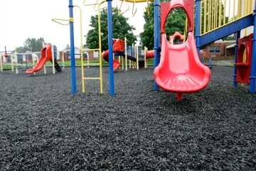 Ground-up recycled tire crumbs cover this playground behind the K-2nd grade elementary Dickerson School in Chester, N.J., Wednesday, June 3, 2009.  The government is reconsidering whether fake turf in playgrounds and sports fields made of ground-up tires could pose health hazards to kids after concerns expressed by some Environmental Protection Agency scientists, according to newly disclosed internal documents from the EPA. (AP Photo/Mike Derer)