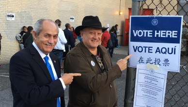 Voter Daniel Pincus poses with 72nd District Assemblyman Guillermo Linares outside the IS 52 polling place in Inwood.