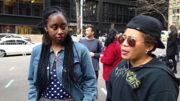 Malika Giddiness (left) and Evan Scott (right) led the rally at Zuccoti Park on Friday, November 27, 2015. Both described being discriminated for being people of color after the event