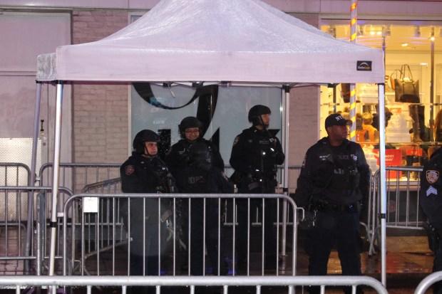 Police man entrance to Rockefeller Plaza. (The Ink/Nadeem Shad)