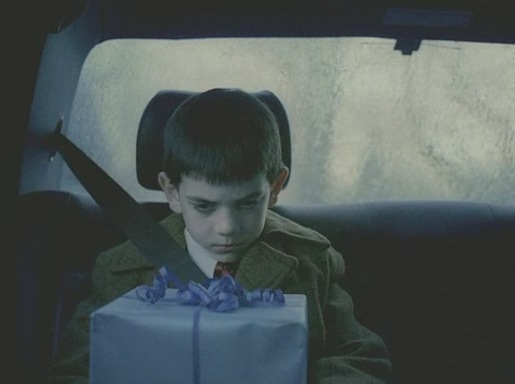 Boy with foresight and present in backseat for Got Milk commercial