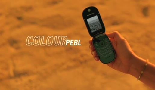 Colour Pebl picked up on tropical beach in Motorola TV ad