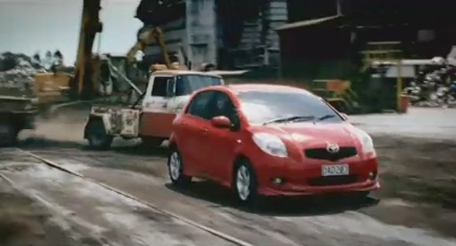 Toyota Yaris chased by tow trucks