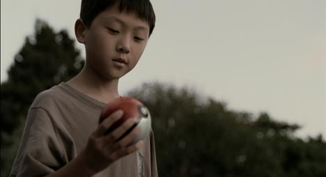 Boy looks at Pokeballs falling from the sky in Nintendo TV ad