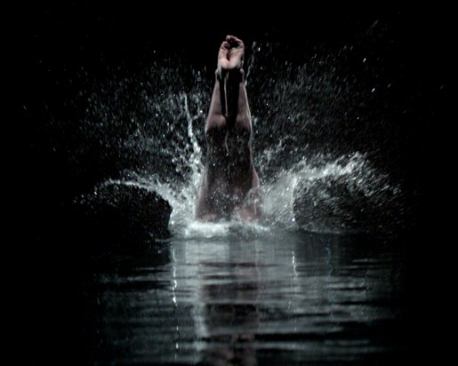 Diver enters water in Acura TV commercial