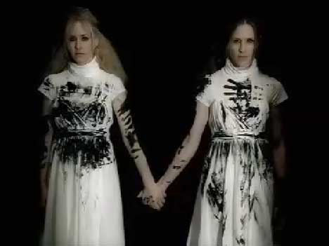 Martie and Emily with black handmarks on their dresses