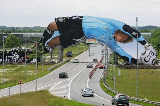 Oliver Kahn dives over the Munich airport motorway