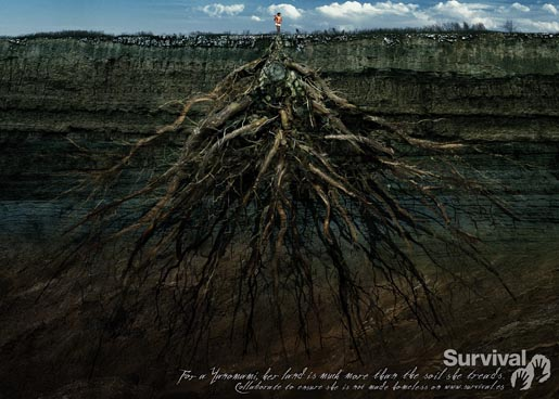 Yanomami woman stands over roots in Survival advertisement