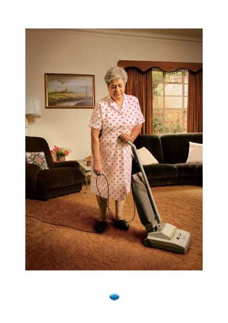 Women falls asleep using vacuum cleaner in Viagra print ad