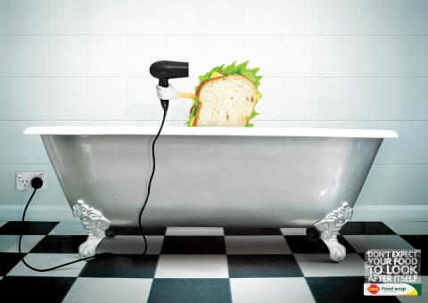 Sandwich about to use hairdryer in bath