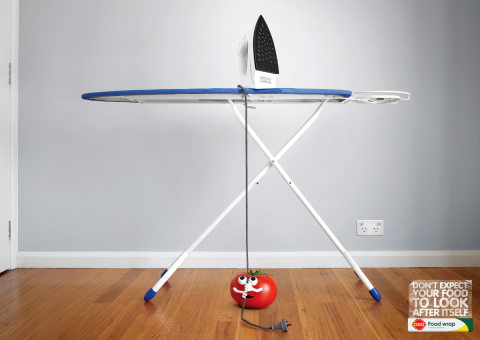 Tomato about to pull iron off ironing board