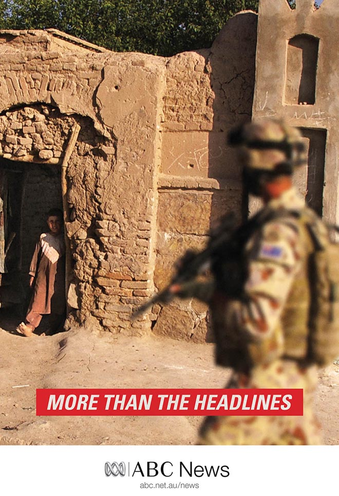 Soldier and child in ABC News print advertisement
