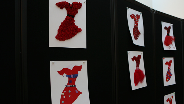 "Red dresses, as part of the ""Go Red for Women"" campaign, are on display in the office of human resources. Submissions end Feb. 22."