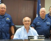 Chapin Mayor Skip Wilson signs a proclamation declaring May 21-27 as Safe Boating Week, with U.S. Coast Guard Auxiliary Flotilla Commander Festus Burchfield, Flotilla Staff Officer-Public Affairs Bill Lindsay and member Matthew Lindsay in attendance.