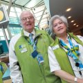 Benno &quot;Ben&quot; Ganz (left) standing beside fellow Green Coat volunteer at YVR. Photo by Elton Hubner.