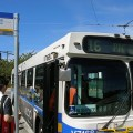 Passengers board a TransLink bus. - Photo by Dennis S. Hurd, Flickr