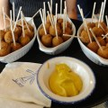 Bitterballen, a Dutch snack served at events such as Queen's Day, is popular amongst the Dutch and others. - Photo by Erna van Balen