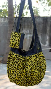a.ku designs green and black floral bag